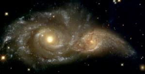 Grazing encounter between NGC2207 and IC2163, Hubble image.