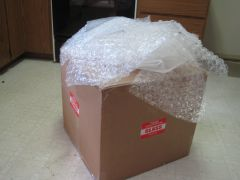 Shipping box and bubble wrap. When I put the bubble wrap back in the box,, I could barely close it.
