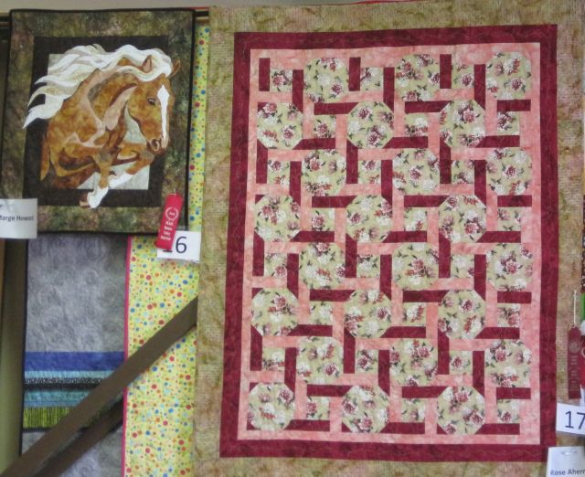 The quilt on the right has fair theme and colors