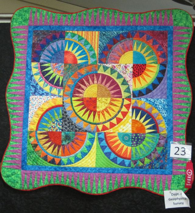 A baby quilt, each block made by a different person, but all followed the rule of bright colors.