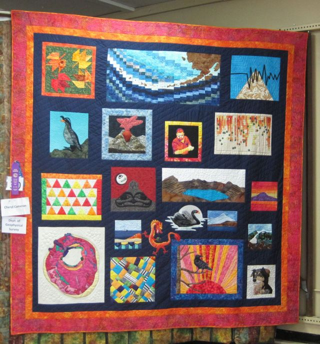 Retirement quild for Chris Nye. Most of the blocks have something to do with volcanoes, though a couple such as his portrait are more personal.